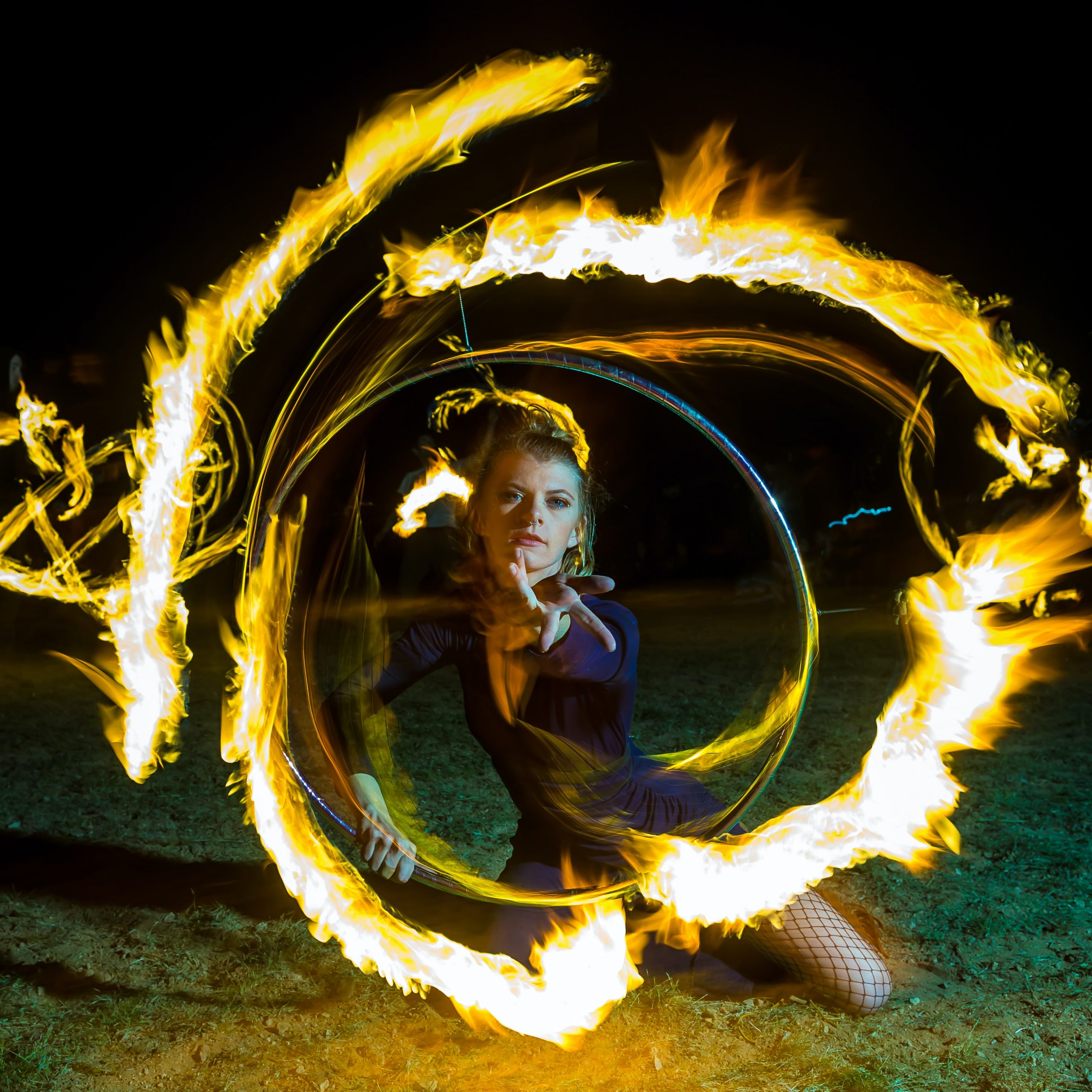 a woman with circles of fire